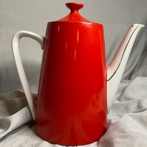 Teapot red with white/gold trim made in Japan.